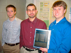From left, Matthew Morton (project manager), Matt Nuckols (developer), and Chris Stewart (developer) - holding a Tablet PC.