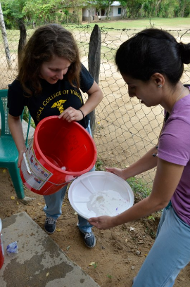 Kate Pearson (rising fourth-year medical student in black T-shirt) cleaning a water filter with Marilena Lekoudis, D.O., (medicine  second-year resident) in La Hicaca, Honduras. Photos courtesy of the Global Health and Health Disparities Program.