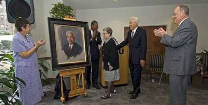 Esther C. Brandt (center) and Warren W. Brandt admire the newly unveiled portrait of Brandt, VCU's first president, which will hang on the east wall of the Community Room, located on the first floor of Brandt Hall. Lois E. Trani (left), Henry G. Rhone, VCU vice provost for student affairs and enrollment services, and VCU President Eugene P. Trani lead the applause. 